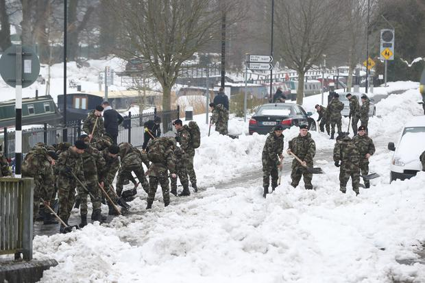 Irish Defence Forces cadets take part in the clean-up after the 'Beast from the East' (Niall Carson/PA)