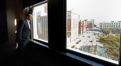Taoiseach Leo Varadkar looks out of the 7th floor window of the Dallas County Administration Building in Dealey Plaza (Niall Carson/PA)