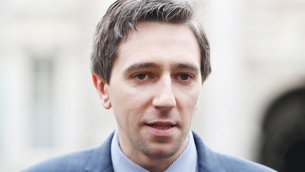 Health Minister Simon Harris has cancelled an overseas trip to concentrate on the hospital overcrowding crisis (Niall Carson/PA)