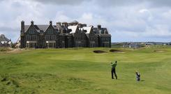 A golfer on the Doonbeg Golf Links course and hotel in Co Clare (Niall Carson/PA)