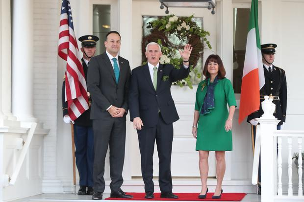 Taoiseach Leo Varadkar is greeted by US vice president Mike Pence and wife Karen (Niall Carson/PA)