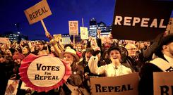 Marchers calling for the repeal of the Eighth Amendment (Niall Carson/PA)