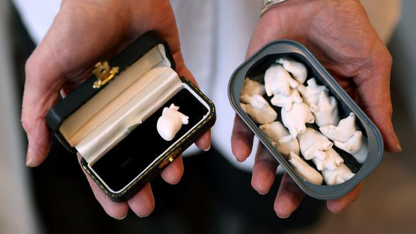 Fine Arts student Bonnie Kavanagh holds her collection of tiny porcelain hearts (Brian Lawless/PA)