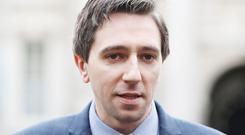 Health Minister Simon Harris said the settlement had avoided the need for a costly and protracted legal battle (Niall Carson/PA)