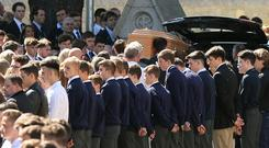 Eoghan Culligan's coffin is carried during his funeral in 2015 (Niall Carson/PA)