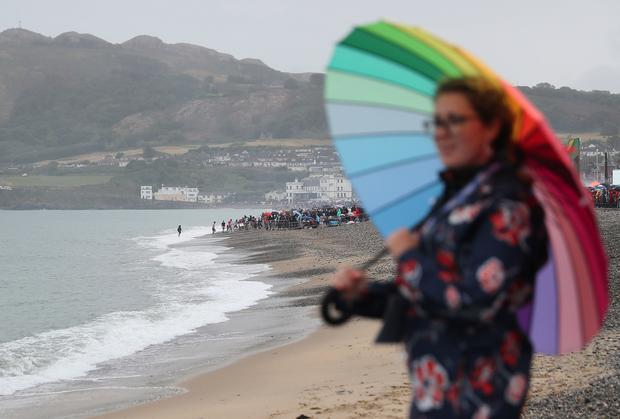 Some people came prepared for the rain and wind (Brian Lawless/PA)