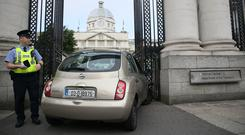 A car that crashed into the gates of Government Buildings in Merrion Street Upper, Dublin (Brian Lawless/PA)