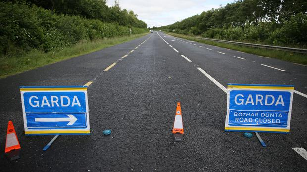 A Garda road closure sign (Brian Lawless/PA)
