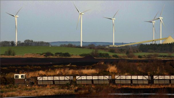 A peat bog and a wind farm (Julien Behal/PA)