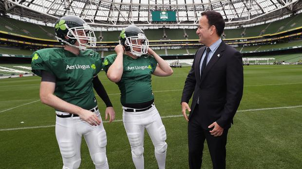 Taoiseach Leo Varadkar with American football players (Brian Lawless)