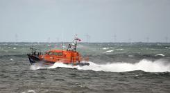 An RNLI lifeboat took part in the search for the windsurfer (Joe Giddens/PA)