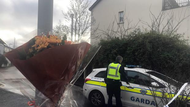 Flowers left at the scene of the shooting (Aoife Moore/PA)