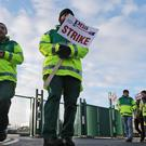 Some of the 500 ambulance staff from the Psychiatric Nurses Association, who are staging a 10-hour strike, take part in a picket outside an ambulance station on Dublin's Davitt Road in a dispute over union recognition (Niall Carson/PA Wire)