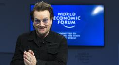 Bono arrives for a panel session during the World Economic Forum in Davos, Switzerland (Laurent Gillieron/Keystone via AP)