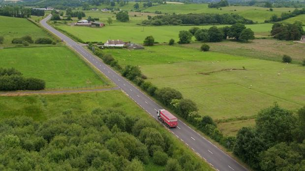 A picture taken with a drone of a Border crossing between Co Fermanagh in Northern Ireland and Co Monaghan in the Republic of Ireland near the town of Clones (Niall Carson/PA Wire)