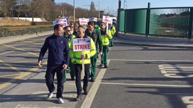 Handout photo issued by the Psychiatric Nurses Association (PNA) of staff from the National Ambulance Service taking part in a strike outside an ambulance dispatch centre in Dublin.