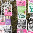 Posters calling for Yes and No votes in last year's referendum (Niall Carson/PA)