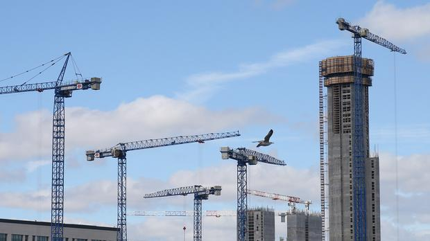 Cranes on a building site in Dublin (Niall Carson/PA)
