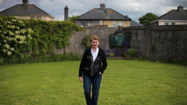 Local historian Catherine Corless at the site of a mass grave for children who died in the Tuam mother and baby home, Galway (Niall Carson/PA)