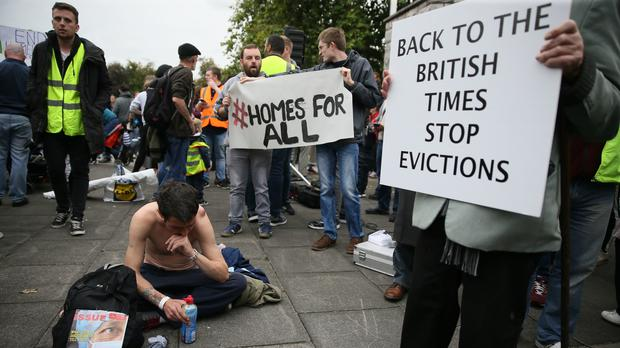 A homeless man attends a previous demonstration in Dublin (Brian Lawless/PA)