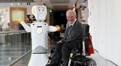 Ireland's first socially assistive AI robot 'Stevie II' from robotics engineers at Trinity College Dublin, with Brendan Crean (Brian Lawless/PA)