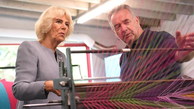 The Duchess of Cornwall is shown a loom during a visit to Avoca Mill in Co Wicklow (Neil Hall/PA)