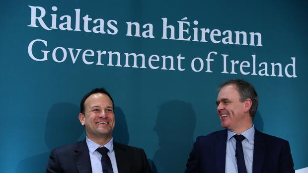 Joe McHugh and Leo Varadkar in front of signage in Gaeilge and English (Brian Lawless/PA)