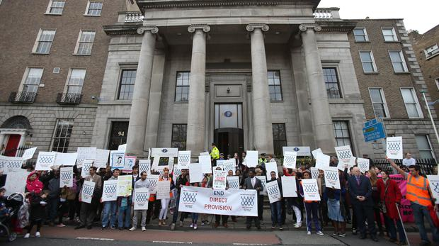 Asylum seekers, refugees, human rights supporters and members of the public march to the Department of Justice to send a message to the Government demanding an end to the system of institutionalised accommodation for asylum seekers, known as Direct Provision (Niall Carson/PA)