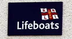 'Roy Hill, a cousin of the late Henry Tomkin from Co Wexford, was among hundreds of well-wishers who turned out for the christening of the Michael O'Brien at the Clogherhead lifeboat station on Saturday'