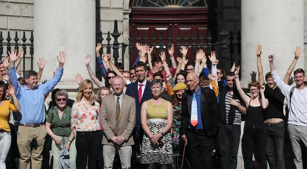 Friends of the Irish Environment (from third left to right) Clodagh Daly, David Healy, Andrew Jackson, Sadhbh O'Neill and Tony Lowes and supporters at the Four Courts in Dublin ahead of the judgement in the landmark case under the name Climate Case Ireland.