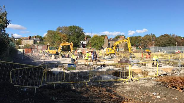 Work continues on the construction site at the O'Devaney Gardens (Michelle Devane/PA)