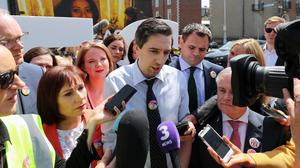 Health Minister Simon Harris speaks to the media at the Together for Yes billboard launch in Dublin (Niall Carson/PA)