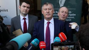 Gary Owens, interim CEO of the FAI, (centre) with Minister of Sport Shane Ross (right) and Minister of State Brendan Griffin at the announcement of a financial rescue package for the association last January (Brian Lawless/PA)