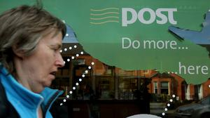 A woman makes her way to the post office on Botanic Road, Glasnevin, Dublin, as postmasters will campaign for people to vote against the Government unless a six point plan to save post offices is adopted