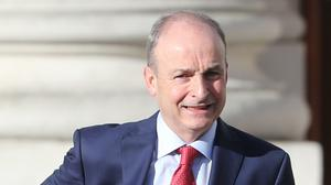 Taoiseach Micheal Martin outside Government Buildings in Dublin this morning on his way to a press conference where he is likely to be asked about accusations that the Tanaiste, Leo Varadkar, leaked confidential governement documents (Niall Carson/PA)
