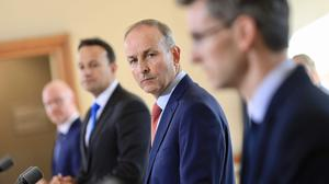 (left to right) Minister for Health Stephen Donnelly, Tanaiste Leo Varadkar, Taoiseach Micheal Martin and Dr Ronan Glynn during the post cabinet press briefing (Julien Behal Photography/PA)