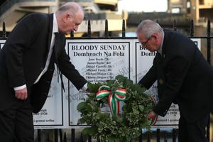 Niall Ring (left) and Brian O'Neill, executive members of the 1916 Relatives Association lay a wreath outside Croke Park to mark the centenary of Bloody Sunday (Brian Lawless/PA)