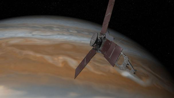 An artist's impression of the Juno spacecraft approaching Jupiter (Nasa/PA)