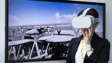 A woman wearing a virtual-reality headset during a demonstration at a recent Uber event in Japan. Photo: Bloomberg