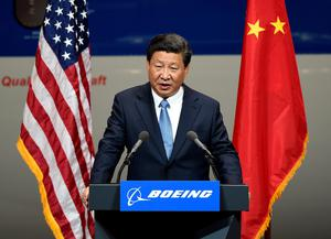Chinese President Xi Jinping speaks after his tour of the Boeing assembly line in Everett, Washington