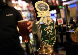 File photo dated 07/03/2011 of a pint of Greene King IPA ale being poured, as two of the UK's biggest pub companies are set to join forces after they agreed a takeover deal worth £773.6 million. PRESS ASSOCIATION Photo. Issue date: Tuesday November 4, 2014. The acquisition of Chef & Brewer owner Spirit Pub Company by Greene King will create a firm with more than 3,000 managed and leased pubs. See PA story CITY Spirit. Photo credit should read: Yui Mok/PA Wire