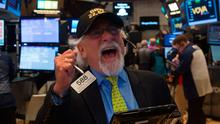 A trader wears a Dow 22,000 points hat on the floor at the closing bell of the Dow Jones Industrial Average at the New York Stock Exchange    Photo: AFP/Getty