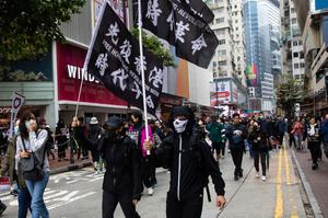Year of upheaval: Protesters continued to take to the streets of Hong Kong in January