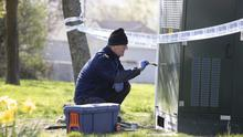 Sabotage: A Garda forensics officer at the scene of the fire at a mast near Letterkenny hospital