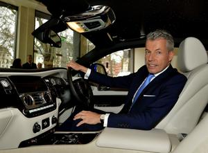 Chief Executive of Rolls-Royce Motor Cars Torsten Muller Oetvoes sits in a Rolls Royce car in the company's Berkley Square showroom in Mayfair, London, before the announcement of their annual financial results