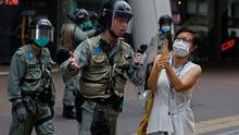 Tensions: Protests have resurfaced in Hong Kong as the US warned the territory no longer warrants special treatment
