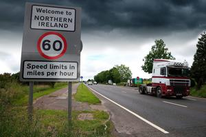 Storm on the horizon: Traffic crossing the border between the Republic of Ireland and Northern Ireland in the village of Bridgend, Co Donegal
