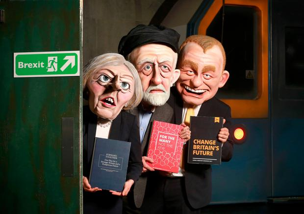Actors dressed as British political leaders Theresa May, Jeremy Corbyn and Tim Farron at an event to encourage young people to vote