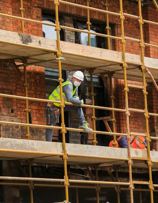 Sites: Construction staff get back to work in Dublin city centre. Photo: Gareth Chaney/Collins