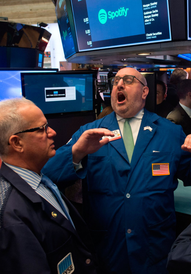 Traders at work as Spotify Technology made its debut on the New York Stock Exchange yesterday. The music-streaming company's shares opened well above their offer price (NYSE)